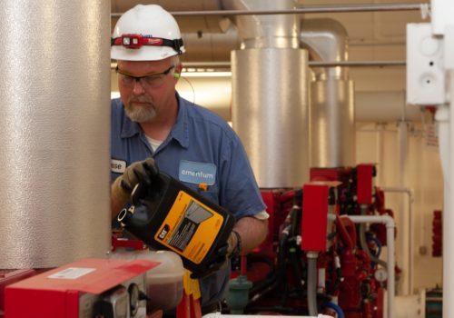 Amentum Mechanical Engineer Jesse Performs Planned Maintenance on Hangar Fire Safety Pump